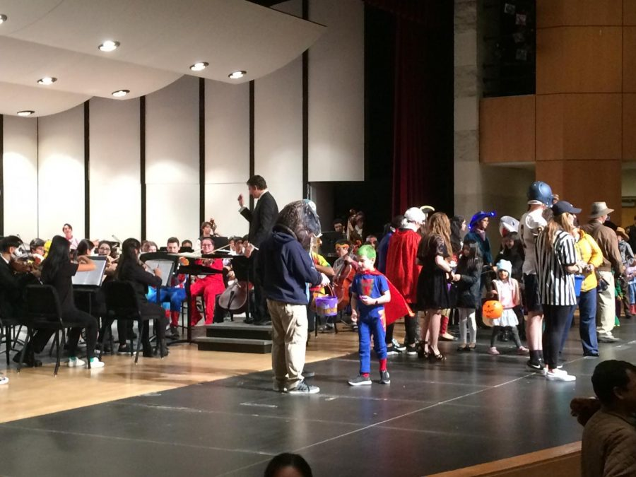 """The Wildcat Fiddlers lead the costume parade and hand out candy while the Neuqua Valley Symphony Orchestra plays """"The Phantom Regiment."""""""