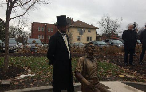 Abraham Lincoln regards his younger, metallic counterpart.