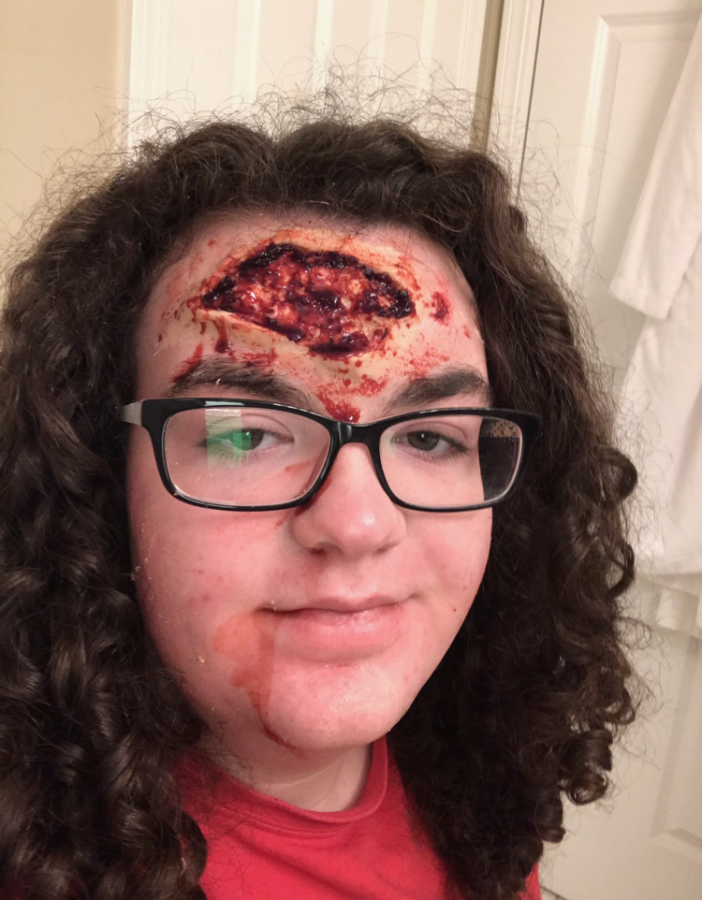 Shea Maloney shows off special effects makeup that she has done on both herself and  the Naper Settlement zombies. She often takes time to practice on herself to improve.