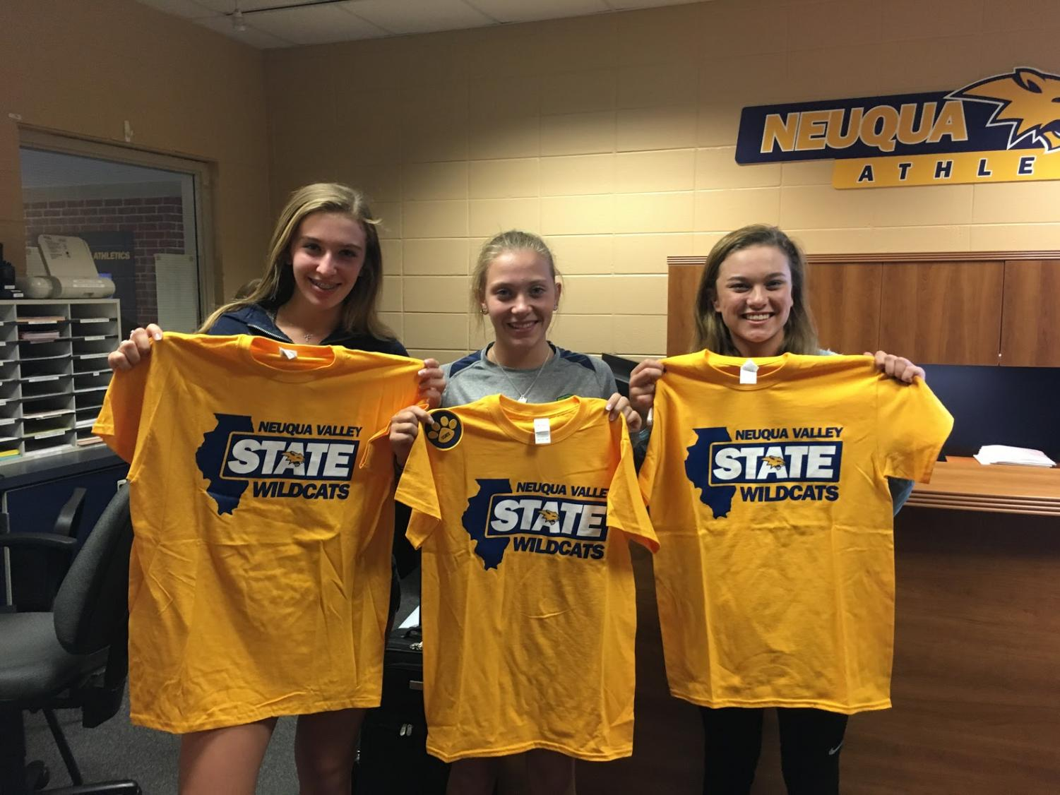 Listed from left to right: Hanna Beck, Hannah Neuman, and Jessica Chivini. The 2017 girls varsity tennis players receiving their shirts before heading to state. Chivini is the only one of the three players who trains at Acceleration, while Beck and Neuman opted to not take part in the program and were still able to secure a spot at state. Photo courtesy of Jessica Chivini.