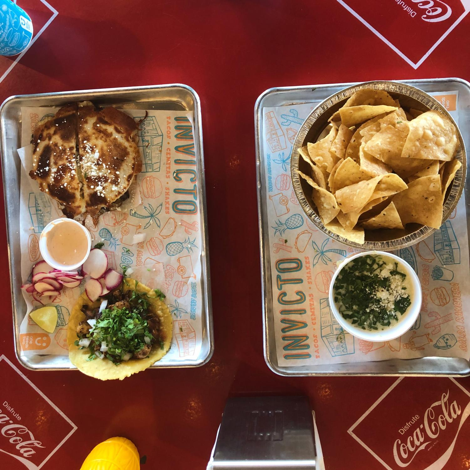 On+left+there+is+the+chicken+taco+and+the+chicken+quesadilla.+On+the+right+is+the+chips+and+queso.++