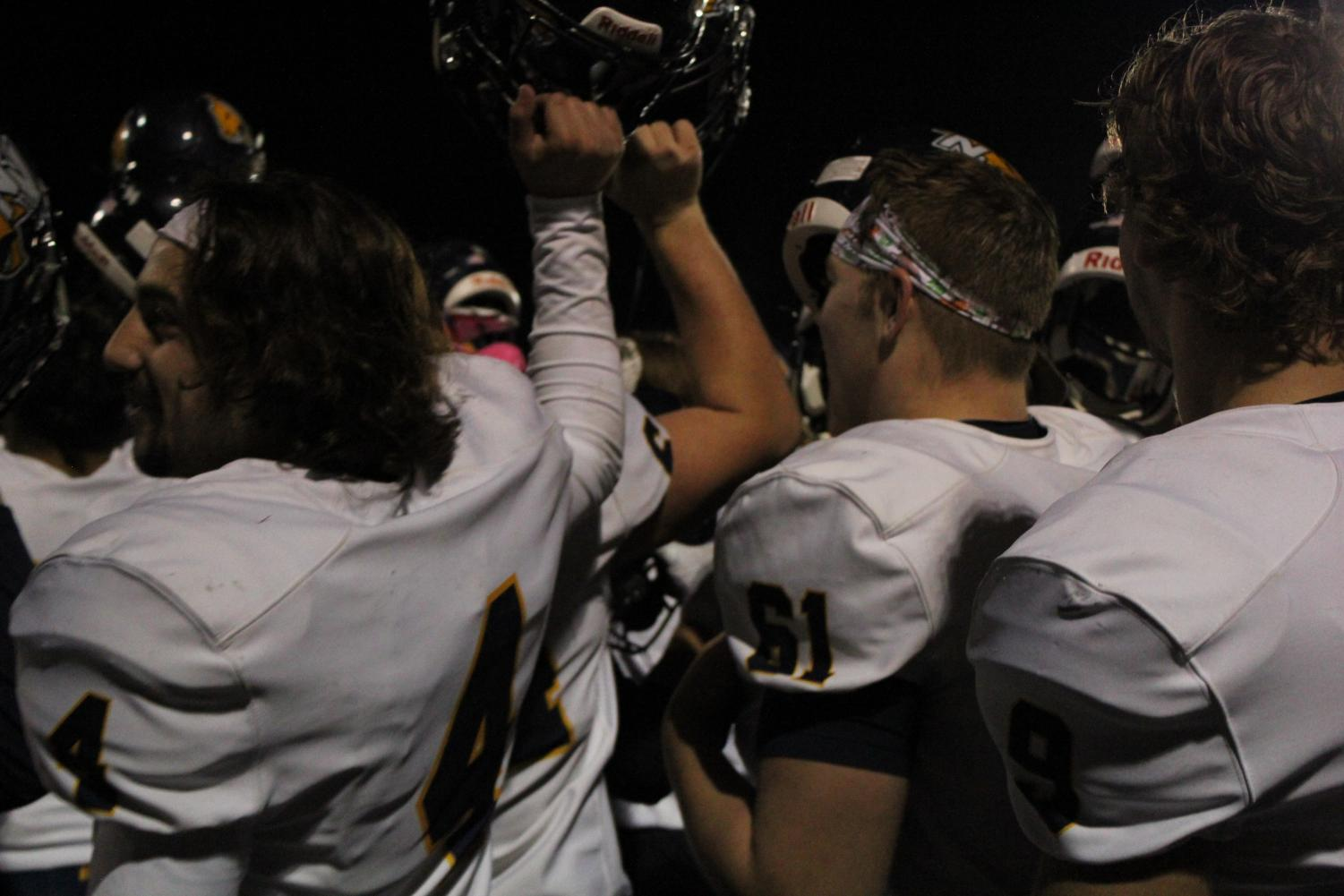 Neuqua Valley advances to the playoffs. This is a photo of the team celebrating with Gold Rush.