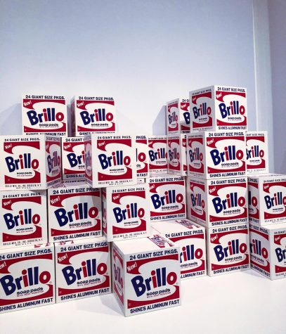 A colorful stack of red, white, and blue Brillo shipping boxes.