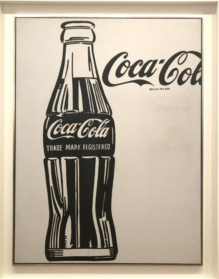 This+print+of+a+Coca+Cola+bottle+is+a+clear+example+of+Pop+Art%2C+which+is+a+style+of+art+that+showcases+popular+media+through+art.