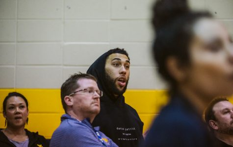 Chicago Bulls  player Denzel Valentine watches the Neuqua game with a reaction that speaks for the whole crowd. Photo courtesy of Jason Verdin.