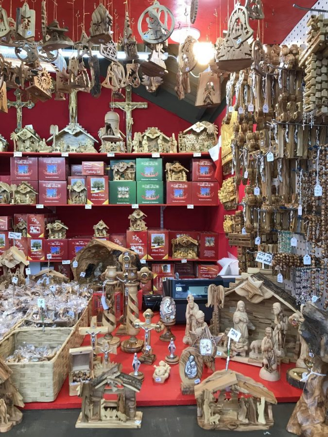 The details of his hand-crafted work are shown in this picture. He sells the iconic nativity scenes, as well as a variety of Christmas ornaments which are hung from the top of the stall.