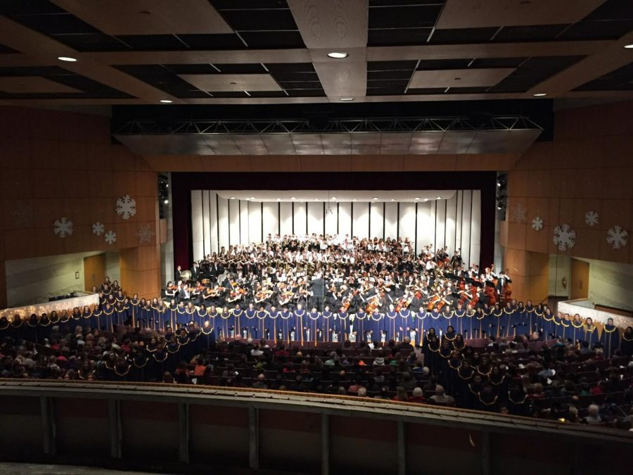 This is the classic arrangement of all the ensembles at Neuqua. The band is on the risers, the orchestra on the stage floor, and the chorus surrounding the audience in the aisles.