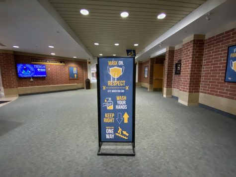 Social distancing and mask wearing signage are on display at all parts of the main hallways.