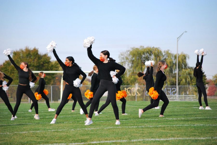 Along with the rest of her team, JV  Captain Kaitlyn Heise wears Halloween Themed poms and masks