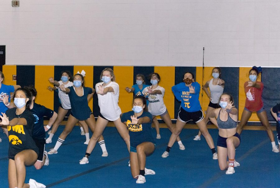 Cheer Team showcases their tumbling their own dance, put together by senior members.