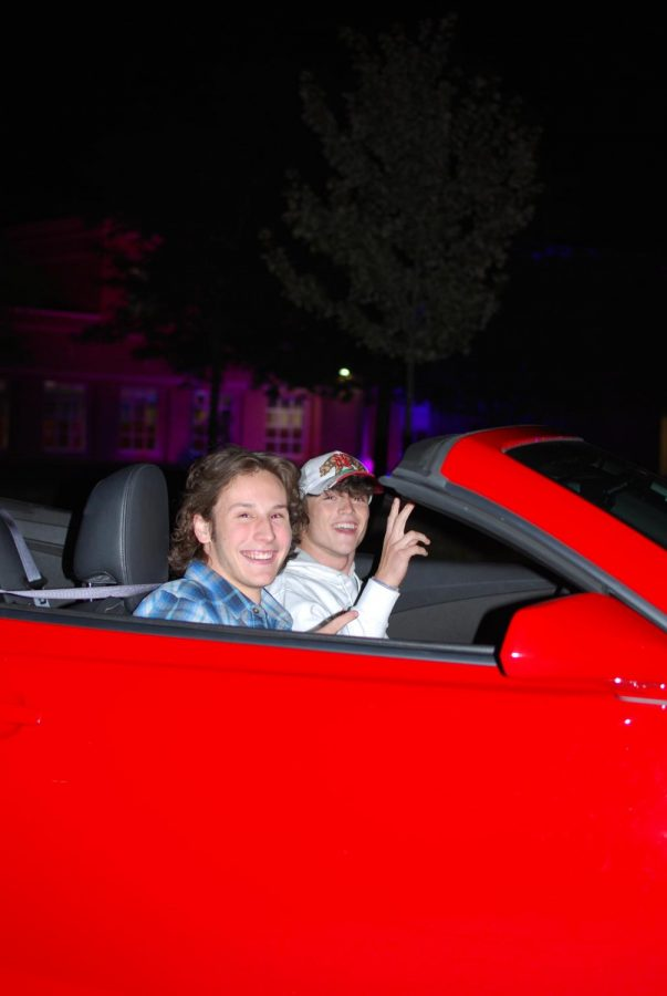 Jimmy Ashley and Cade Hahn pulled up to celebrate their senior year in a red convertible.