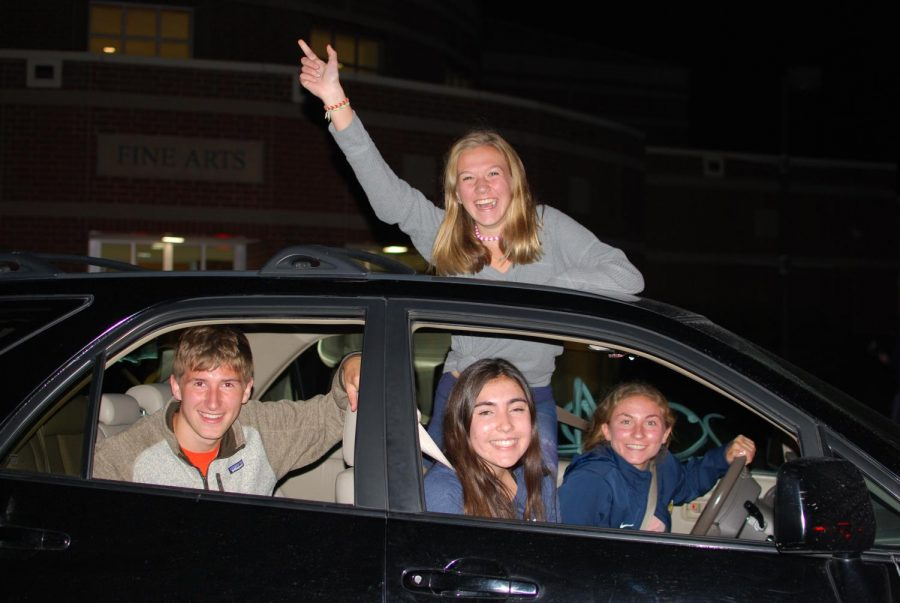 Sydney Kearns, Emily Stine and Maria Widmann riding in a packed car to get their free shirts for the first 300 students in line.