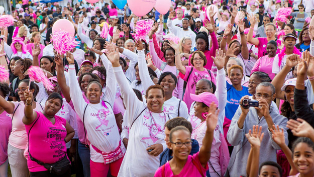 People clad in pink getting ready for the Avon Walk for Breast Cancer