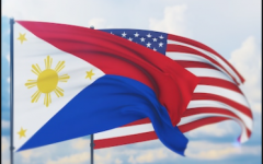 The flag of the Philippines and the US flag flying together in unity.