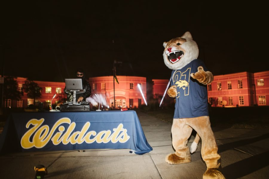 Willie the Wildcat dancing along with the DJ at the senior car parade. Scroll for more pictures.