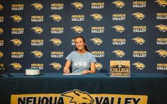 Jane Riehs smiles while signing her National Letter of Intent to commit to the University of San Diego on Nov. 11, 2020.