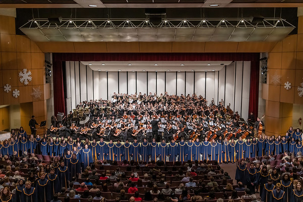 The various groups involved in Neuqua Valley's annual Crystal Concert gather together to perform their final piece of 2019. All performers are present on and along the stage for the finale.