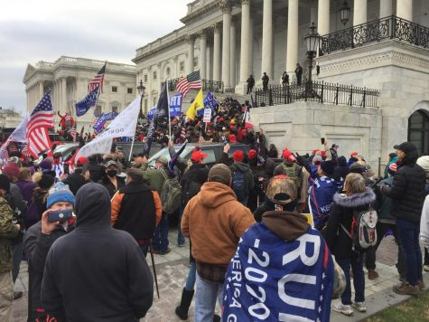 Trump supporters and stolen election conspiracists gather at the Capitol building on January 6, 2021.