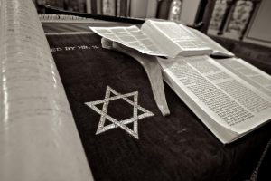 The Star of David is the Jewish symbol composed of two overlapping triangles, creating a star with six points. It appears on synagogues, Jewish tombstones and the Israeli flag.