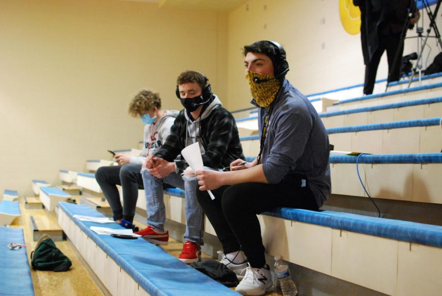 Dominick Liacone commentates on a Neuqua basketball game, accompanied by Jack Ashby and Charlie Rook