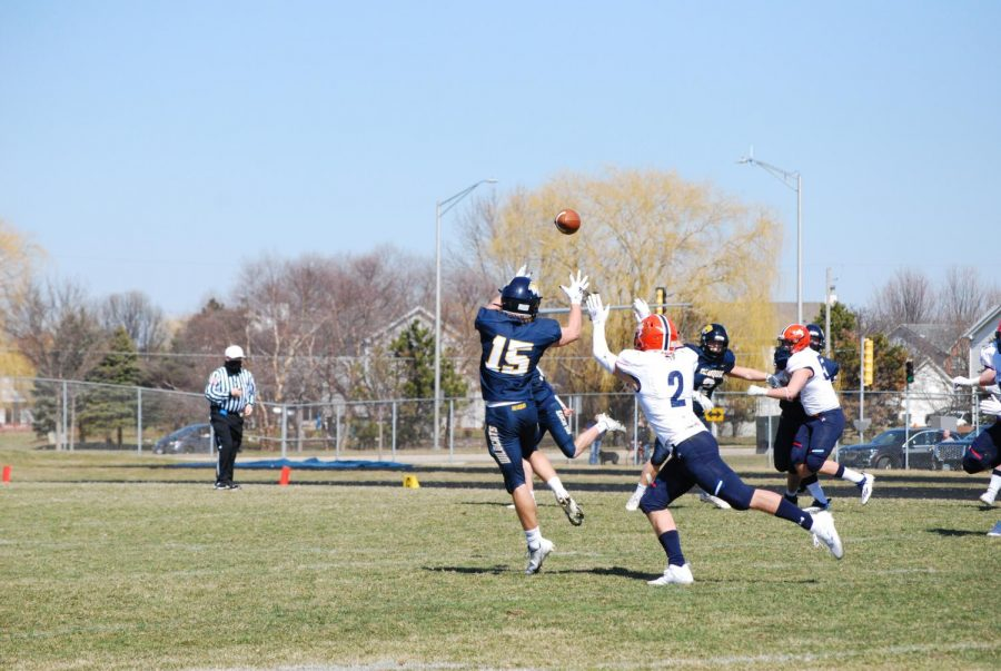 Justin Nonnenmann jumps and snags a pass.