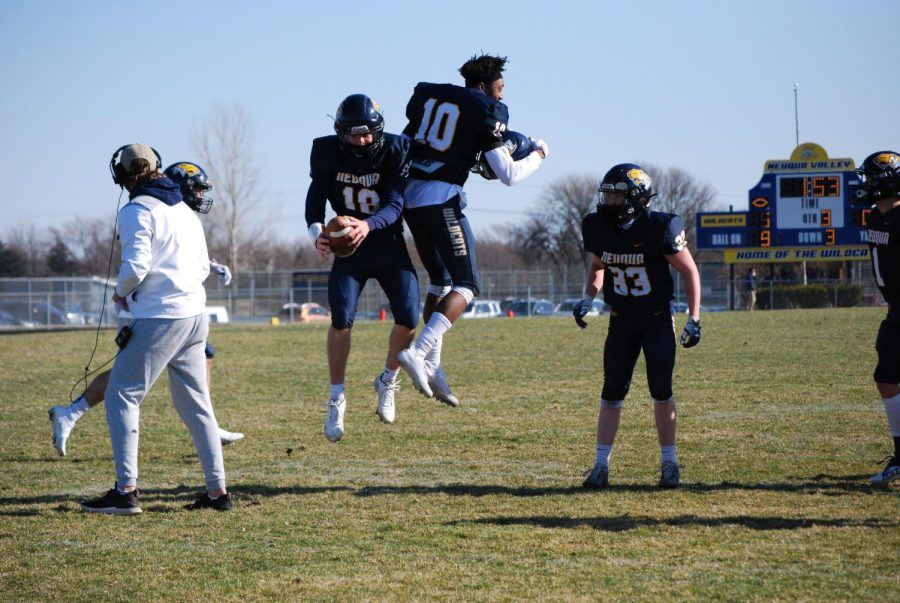 Teammates Mark Mennecke and Andre Cobb celebrate a touchdown.