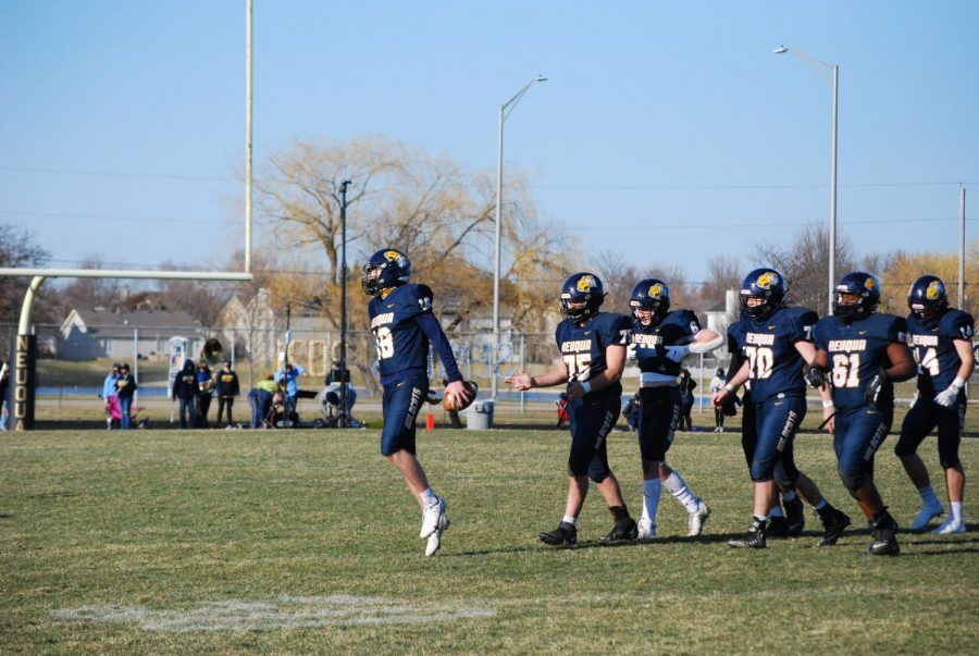 Mennecke, followed by his teammates, celebrates the Wildcats first win of the season.