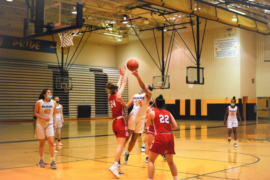 While masked up for the game, Jada Devine shoots a lay-up.