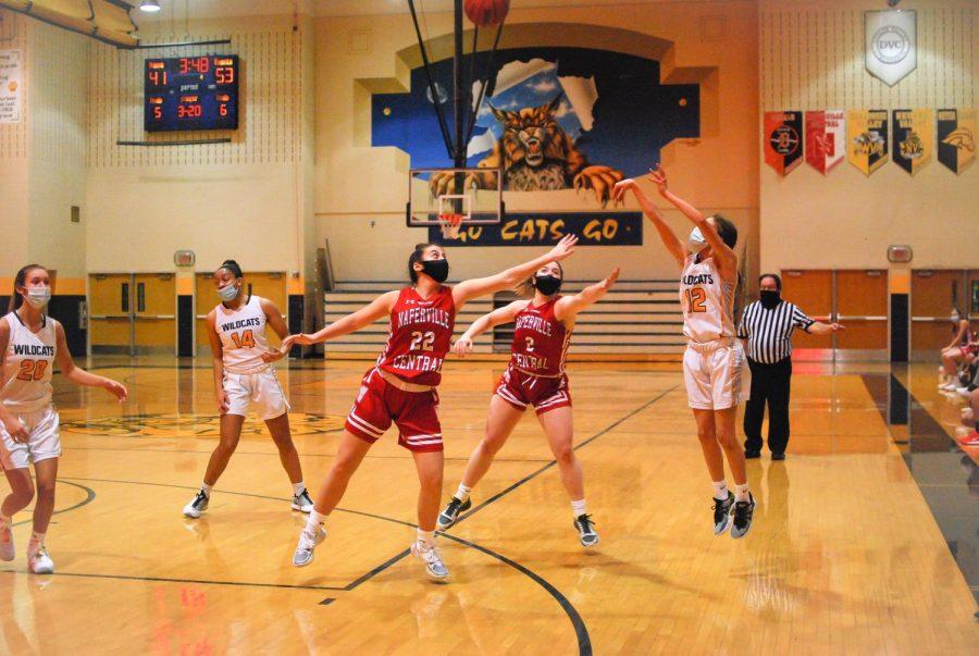Zoe Navarro, one of three freshman on varsity this year, takes a three.