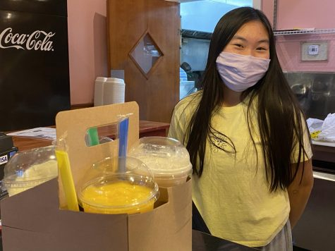 Huynh serving boba smoothies at Noodles Pho U. She started working here in mid-October of 2020.
