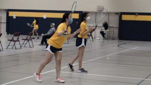 JV team captains Karena Liang (left) and Preena Shroff (right) getting ready to return in their doubles match