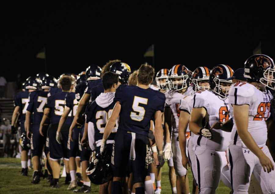 Neuqua Valley and Oswego conclude their game with mutual respect.