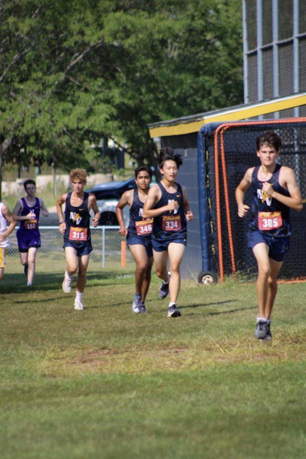 Neuquas Cross Country team ran the race together, being sure to hype up teammates.