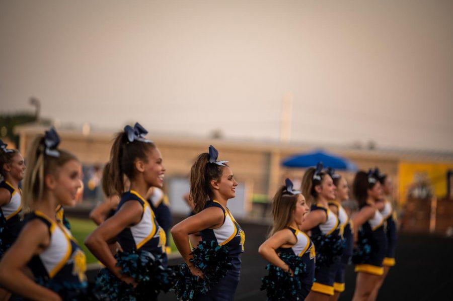 On Friday night, Neuqua Valleys Cheerleaders accompanied the football team on the sideline.