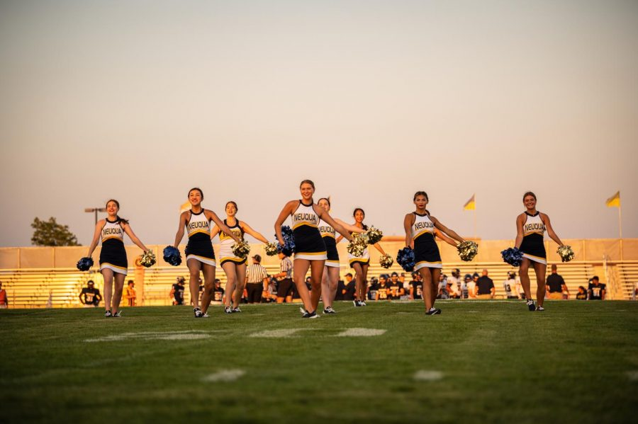 Cheerleaders steal the field on during the football game.