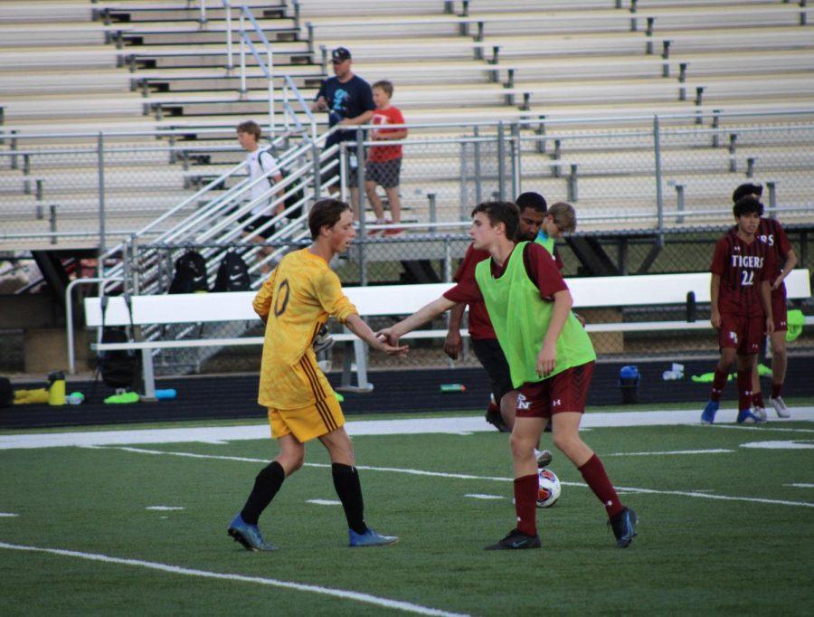 Soccer opponents showing good sportsmanship after the game