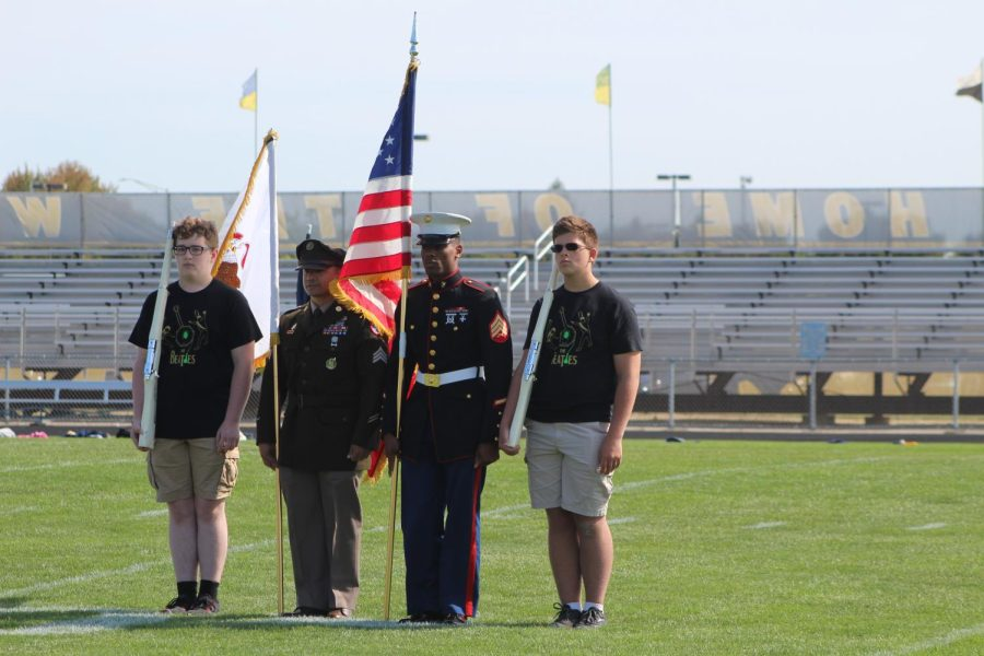 Military Officers presenting the flags at the Pep Rally during the National Anthem