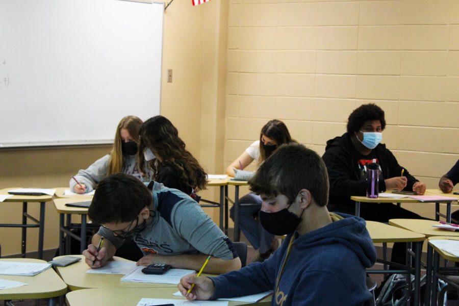 Neuqua students work independently on their math worksheet.