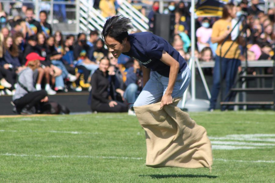 Theo Lin falling during the potato sack race section of the wacky relay