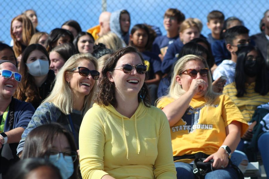Three teachers laughing about the events at the Pep Rally