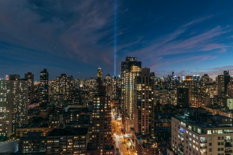 """On every anniversary of the Sept. 11, 2001 attacks, the Tribute in Light is held near the World Trade Center. This art installation features 88 searchlights shone from dusk to dawn, which create two pillars of light that according to 9/11 Memorial & Museum, """"[honor] those killed and [celebrate] the unbreakable spirit of New York."""""""