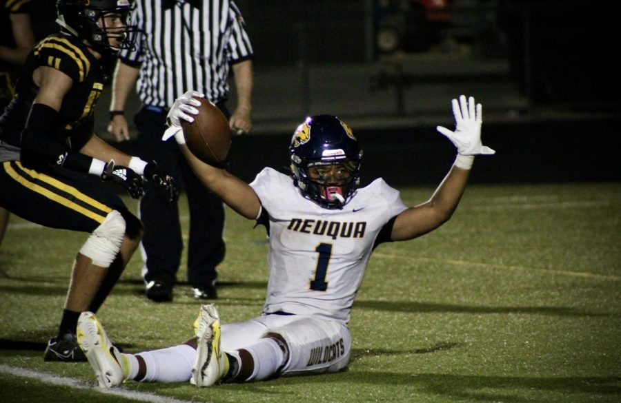 Jaden McGee on the ground celebrating his touchdown.