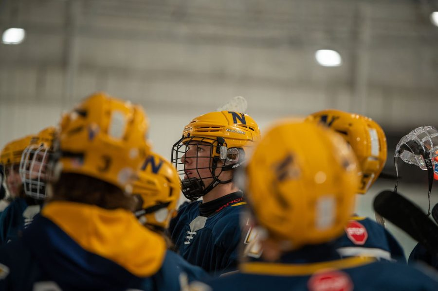 Nick DeMarte tunes in as his coach discusses with the team.